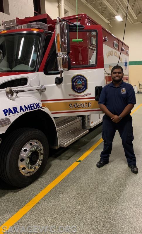 Proud Rohan Harris standing next to Ambulance 66.